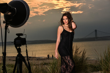 Photo shoot of  beautiful brunette model at the beach during sunset time.