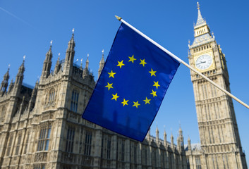 European Union flag hanging in front of Big Ben and the Houses of Parliament at Westminster Palace, London, in preparation for the Brexit EU referendum