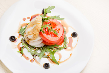 salad with goat cheese and tomatoes in Georgian