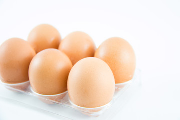 Six brown eggs in a case