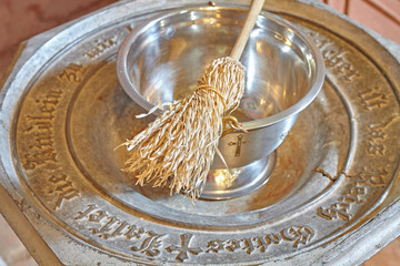 Baptismal font with sprinkler, shallow depth of field
