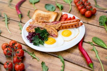 Breakfast, eggs on toast on wood table