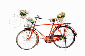 Old red bicycle with flower in basket isolated on white backgrou