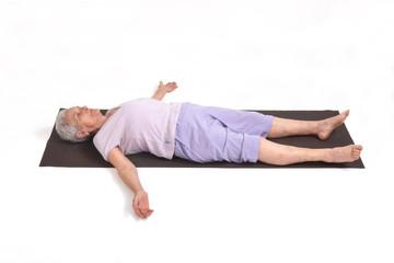 Senior woman doing yoga, isolated