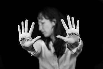 Stop violence against women. .Woman with mouth closed with patch