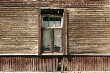 Window of old abandoned wooden house.