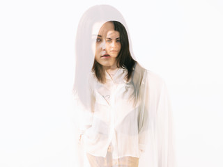 Double exposure of girl portrait wearing white blouse