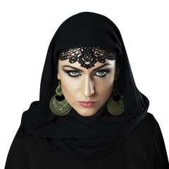 Beautiful Caucasian young woman with black fancy Arabian costume