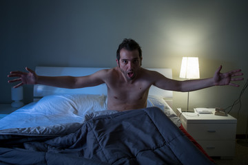 Man sleepless in his bed screaming after nightmare