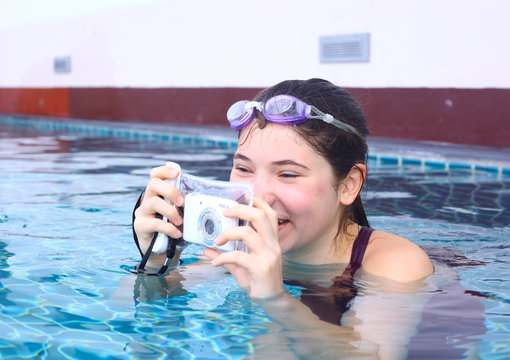 girl in water glasses close with underwater camera