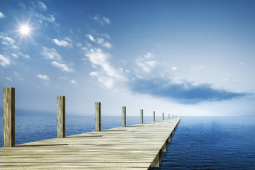 wooden jetty blue ocean