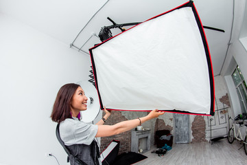 Studio light flashes equipment on light wall background