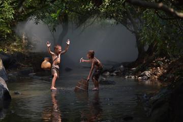 Boys Fisherman fishing at river