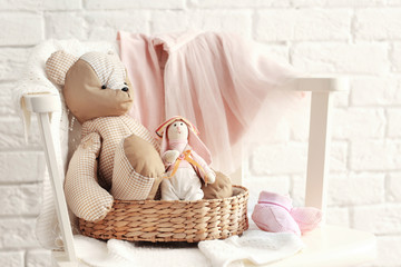 Baby toys and clothes on brick wall background
