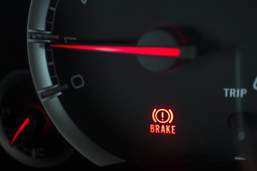 Close up Brake light signal icon on the car panel