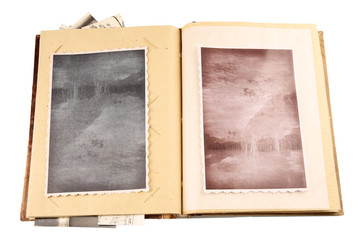 Vintage photos in album isolated on white