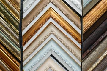Craftsman working on frame in frame shop. Professional framer hand holding frame angle. Top view