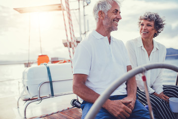 Mature couple sitting on yacht