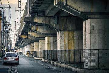 Underclass. Rails on concrete in Osaka, Japan.