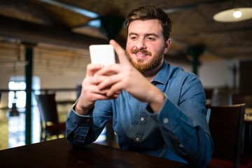 Man text messaging on mobile phone