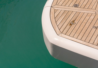 wooden deck of a yacht on sea background