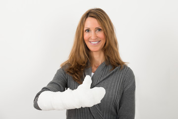 Woman With Broken Hand In Bandage