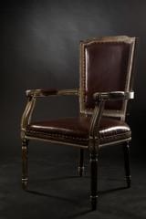 Dark genuine leather vintage chair