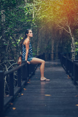 Young woman travelling at mangrove forest.