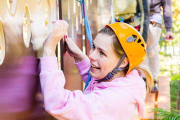 girl climbs into ropes course
