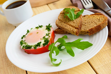 Scrambled eggs, baked in a ring bell pepper, toast, arugula leaves and a cup of coffee. Light breakfast.