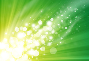 Green glitter sparkle defocused rays lights bokeh beautiful abstract background.