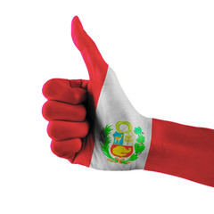 Peru flag painted hand showing thumbs up sign on isolated white background with clipping path