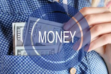 Money icon. Money in cotton shirt pocket, close up