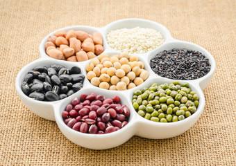 Multicolored beans in ceramics bowl.
