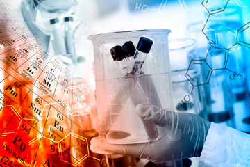 Scientific concept, gloved hand hold a beaker in laboratory room with periodic table and chemical structure background