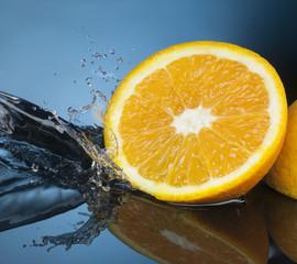 Printed roller blinds Splashing water orange slice in water stream