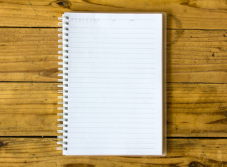 A blank notebook page on table wood office notebook Top view for