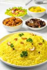 Yellow rice and curry or kaha bath Sri Lankan food