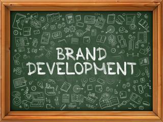 Brand Development - Hand Drawn on Chalkboard. Brand Development with Doodle Icons Around.