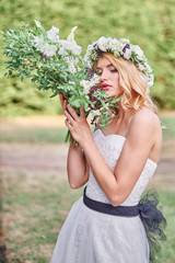 Wedding . Beautiful bride. Love.Beautiful bride with a wreath on his head holding a bouquet. bride