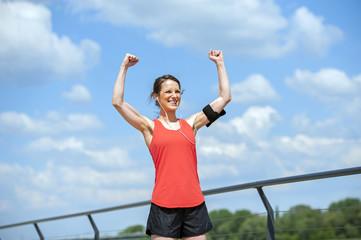 Fit woman jump happy of victory winns.