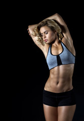 Sport, young fitness girl with slim muscular body posing in the