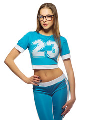 Young sporty woman in blue costume