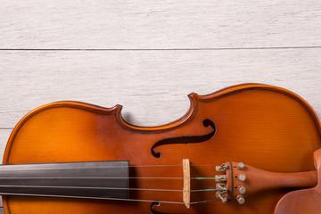 still life of vintage violin on white wooden background