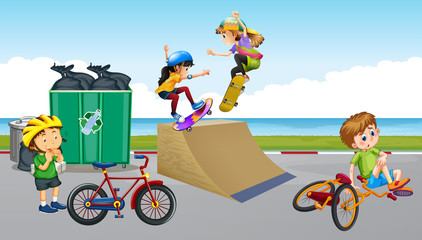 Children riding bike and playing skateboard