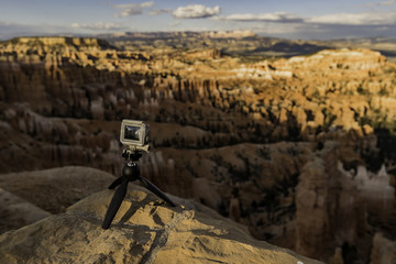 Small camera stand on rock