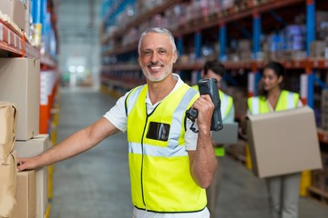 Focus of worker is smiling and posing during work