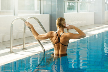 Woman swimmer in the pool