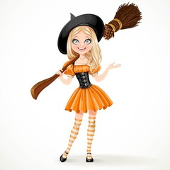 Cute teenage witch in orange dress with a broom on her shoulder