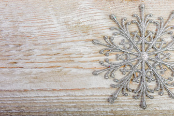 decorative snowflakes on a wooden background